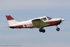 G-BRUD - 1983 build Piper PA-28-181 Cherokee Archer II, climbing after performing a touch & go on Runway 08R at Barton