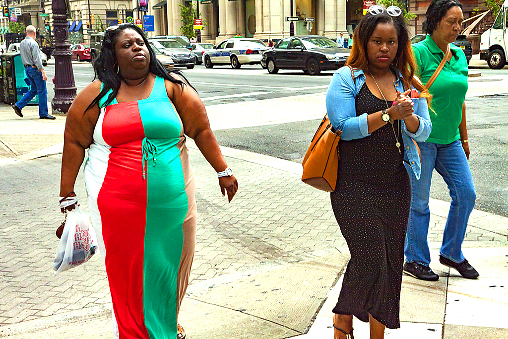 Large woman in green, red, beige and white dress--Center City