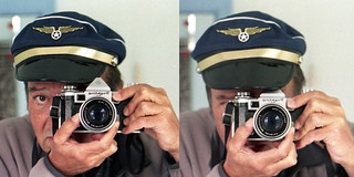 reflected self-portrait with Praktina IIA camera and peaked cap