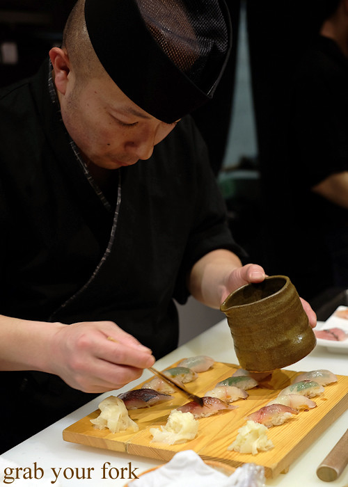 Sushi chef Tomoyuki Matsuya glazing nigiri sushi at Hana Ju-Rin in Crows Nest Sydney