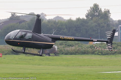 G-SWIG - 2007 build Robinson R44 Raven, arriving at Barton in steady drizzle