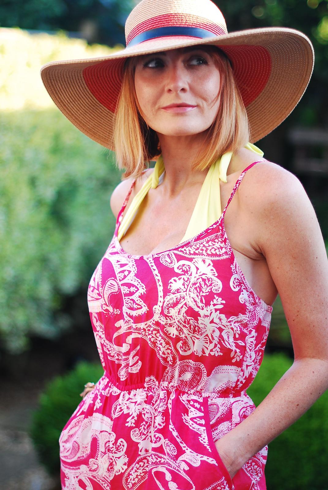 Over 40 style: Yellow bikini, paisley print wide leg beach jumpsuit, floppy sun hat | Not Dressed As Lamb