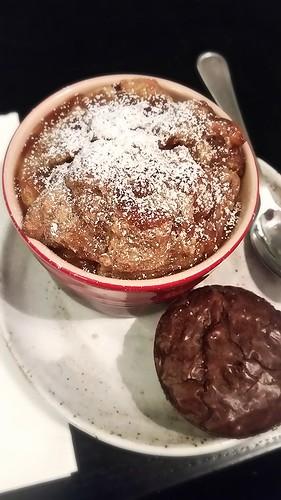 Banana bread pudding with caramel sauce and dark chocolate brownie