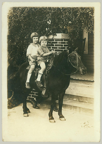 Two children on a horse