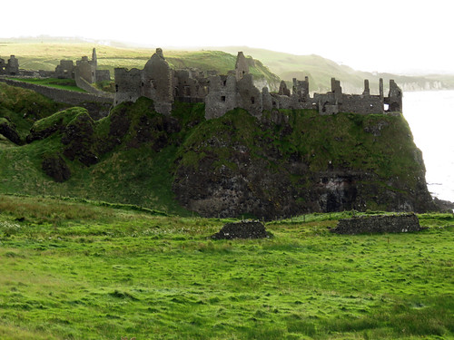 Dunluce Castle ruins in Northern Ireland, UK showing the hexagonal stones quarried from the Giant's Causeway in the evening light