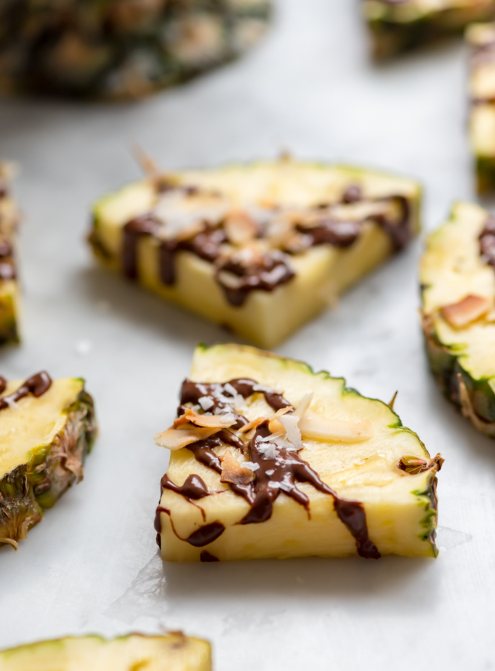 Dark Chocolate Drizzled Fresh Pineapple with Toasted Coconut and Sea Salt www.pineappleandcoconut.com