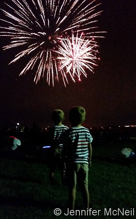 The McNeil twins take in the fireworks on the 4th of July. (Jennifer McNeil)