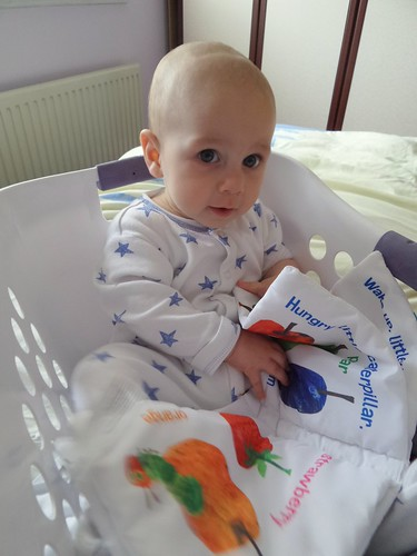 baby sitting in a laundry basket